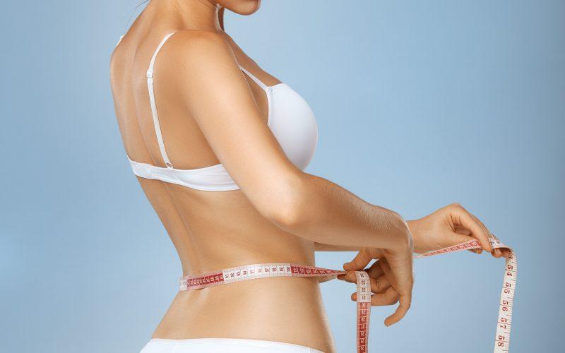 slim-tanned-woman-with-measure-tape-around-waist-ZX9ENYU-min